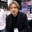 Geezer Butler signs autographs at The 2018 NAMM Show at Anaheim Convention Center on January 26, 2018 in Anaheim, California