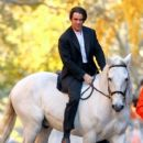 "Colin Farrell is seen riding a white horse on the set ""Winter's Tale"" in New York City"
