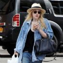 Dakota Fanning as she starts her morning with a iced coffee drink while out and about in New York City (July 11)