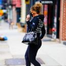 Mariah Carey – Wearing body hugging tights and heels in New York