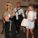 Kim Zolciak is seen at LAX on March 31, 2016 - 454 x 587