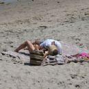 Hilary Duff in Pink Bikini on the Beach in Malibu - 454 x 354