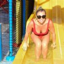 Billie Faiers in Red Swimsuit at a water park in Dubai - 454 x 374