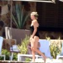 Charlize Theron in Black Swimsuit on vacation in Los Cabos - 454 x 501