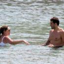 Kelly Brook in White Bikini on the beach in Mykonos