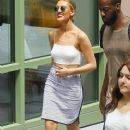 Perrie Edwards and her bandmates from 'Little Mix' treat fans to an acoustic version of their song 'Black Magic' after lunch in Burbank, California on August 6, 2015