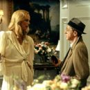 Charlize Theron and Woody Allen in Dreamworks' The Curse of the Jade Scorpion - 2001