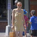 Dakota Fanning in Yellow Dress – Out in New York