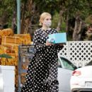 Emma Roberts – Shows baby bump while out shopping in Los Angeles