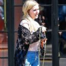 Beverley Mitchell waits for a cab outside The Bowery Hotel in New York City, New York on September 3, 2014