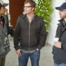 M. Night Shyamalan, Director John Erick Dowdle and Drew Dowdle on the set of Devil.