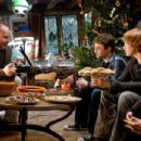 (L-r) Director DAVID YATES discusses a scene with DANIEL RADCLIFFE, RUPERT GRINT and BONNIE WRIGHT in Warner Bros. Pictures' fantasy adventure 'Harry Potter and the Half-Blood Prince.' Photo by Jaap Buitendijk