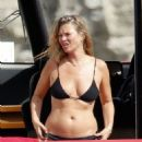 Kate Moss – In bikini on a Luxury Yacht in Ibiza