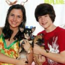Actors Dylan Minnette and Hailey Anne Nelson arrive with their dogs for the grand opening party for the Artist Knox Luxury Grooming Pet Salon on June 27, 2009 in Hollywood, California.