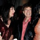 Mick Jagger and L'Wren Scott arrive at the Vanity Fair Oscar party hosted by Graydon Carter held at Sunset Tower on February 27, 2011 in West Hollywood, California - 454 x 335