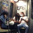 Katie Holmes and Emilio Vitolo Jr. riding the Downtown Subway train in Manhattan