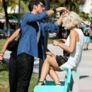work on a shoot in Miami, Florida, on Tuesday. 12/10/13 - 454 x 610