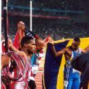Men's 100m medalists, Sydney Olympics 2000 - 454 x 681