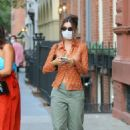 Emily Ratajkowski – Our for a stroll with her dog Colombo and friend and husband in New York City