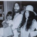 Yoko Ono and John Lennon - Biography Magazine Pictorial [Russia] (1 December 2011) - 454 x 373