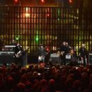 Inductees Joan Jett and The Blackhearts perform on stage with Dave Grohl and Miley Cyrus during the 30th Annual Rock And Roll Hall Of Fame Induction Ceremony at Public Hall on April 18, 2015 in Cleveland, Ohio.