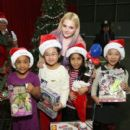 "Abigail Breslin joins Delta Airlines and YMCA of Greater New York for the fifth anual ""Holiday in the Hangar"" a special holiday celebration for P.S. 029 elementary school students, at JFK Airport on December 15, 2015 in New York City"