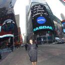 Kat Graham and Cottrell Guidry rings the closing bell at NASDAQ MarketSite on December 31, 2013 in New York City