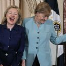 Hillary Clinton and Angela Merkel joke about their mutual love of pantsuits