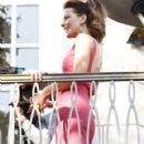 Kate Beckinsale looks fabulous in a pink dress as she's interviewed for a segment on