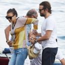 PICTURE EXCLUSIVE: Irina Shayk struggles to contain her perky assets in a skimpy yellow bikini as she cosies up to handsome beau Bradley Cooper on romantic getaway to Lake Garda - 308 x 525