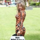 Joanna Krupa – Bodypaint while protesting outside Westminster in London - 454 x 609