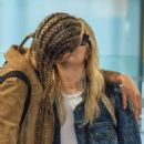 Ashley Benson and Cara Delevingne at Heathrow Airport in London - 454 x 662