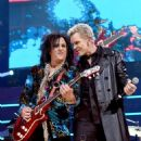 Steve Stevens and Billy Idol perform onstage during the first ever iHeart80s Party at The Forum on February 20, 2016 in Inglewood, California. - 454 x 558