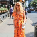 Kylie Minogue in Long Orange Dress – Leaving her hotel in NY