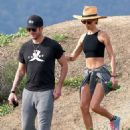 'Newly-engaged' Maggie Q displays her abs in a crop top on hike with 'fiancé' Dylan McDermott