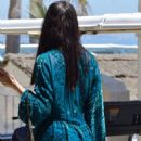 Adriana Lima in Blue Summer Dress at a beach club in Marbella