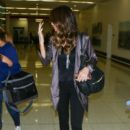 Kate Beckinsale Is Seen at LAX (December 13, 2016)