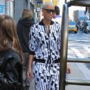 Amber Rose and Tara Reid were spotted posing for fans as they stepped out of their hotel in New York, New York - April 6, 2012 - 371 x 594