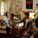 Josh (Breckin Meyer, standing right), who was persuaded to prove his tryst with Beth to his friends, (left to right) E.L. (Seann William Scott), Barry (Tom Green) and Rubin (Paulo Costanzo), is about to realize that a terrible mistake has been made with r