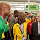 Prince Philip, Duke of Edinburgh talks talks to Jamaican sprinter Asafa Powell during a tour of the Athletes Village dining hall on day one of the London 2012 Olympics Games on July 28, 2012 in London, England
