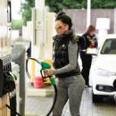 Jemma Lucy in Tights at a gas station in London - 454 x 663