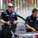 Bald Officer Jake Gyllenhaal: Reporting for Duty