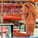 Nicky Whelan in Bikini on the pool in Las Vegas
