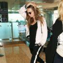 Cara Delevingne Arrives At Airport In Sydney