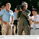 Hartman (Thomas Haden Church, left), Steve (Bradley Cooper) and news producer Angus (Ken Jeong) display varying reactions to a developing news story. Photo credit: Suzanne Tenner