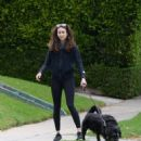 Troian Bellisario – Out for a walk with her dog in Los Angeles - 454 x 505