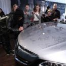 Slash signs the hood of the all new 2015 Acura TLX at the Acura Studio at the 2015 Sundance Film Festival on January 25, 2015 in Park City, Utah.