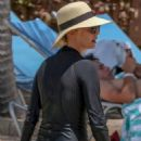 Charlize Theron in Bikini Bottoms at the beach in The Bahamas
