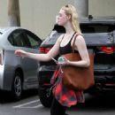 Elle Fanning in Sports Bra – Leaves the gym in LA - 454 x 681