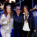 Steven Tyler, Roberto Cavalli and Joe Perry attend the Roberto Cavalli show during the Milan Menswear Fashion Week Spring Summer 2015 on June 24, 2014 in Milan, Italy. - 454 x 303